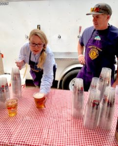President Lou LaManna and Treasurer Kelly Moretti work the Truckee Lions booth during the festival.